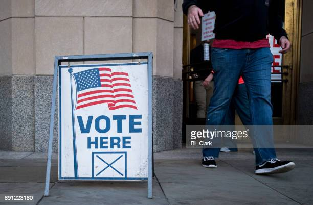 Voters exit the polling station at the Jefferson County Courthouse in Birmingham Ala on Tuesday Dec 12 after voting in the special election to fill...