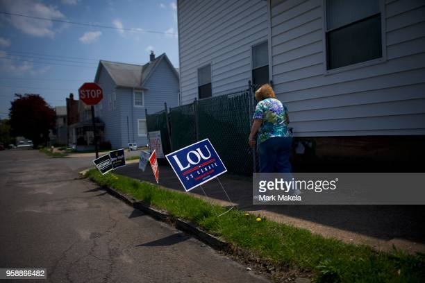 A voters exits the Glen Lyon Italian American Sporting Club polling station after casting her ballot during the 2018 Pennsylvania Primary Election on...
