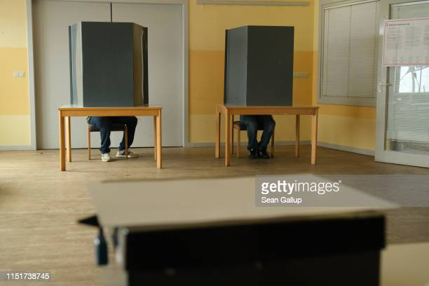 Voters fill in their ballots at a polling station in European parliamentary elections on May 26 2019 in Berlin Germany Today is the last day voters...