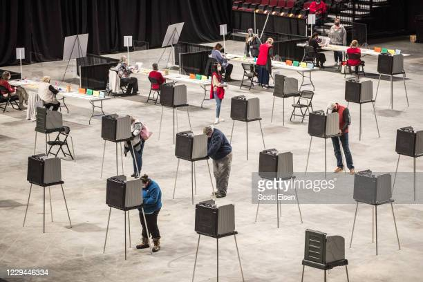 Voters fill out and cast their ballots at the Cross Insurance Center polling location where the entire city votes on November 3, 2020 in Bangor,...