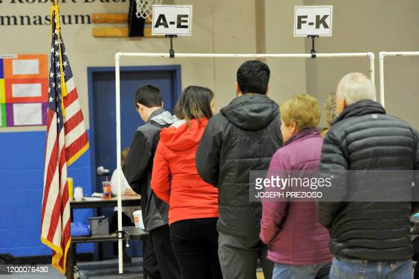 Voters fill out their ballot sheets at the Northwest Elementary School polling station to cast their vote in the New Hampshire Primary in Manchester...