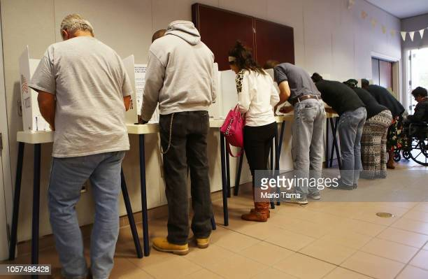 Voters fill out their ballots at a polling place during early voting in California's 25th Congressional district on November 4 2018 in Lancaster...