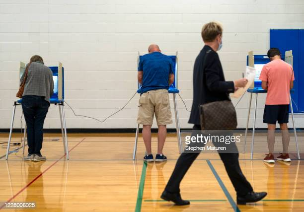 Voters fill out their ballots at a polling place in the Pearl Park Recreation Center on August 11, 2020 in Minneapolis, Minnesota. Amongst other...