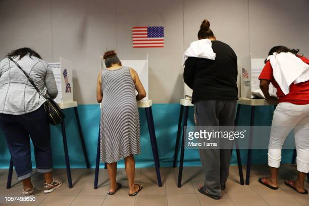 Voters fill out their ballots at a polling place to participate in early voting in California's 25th Congressional district on November 4 2018 in...