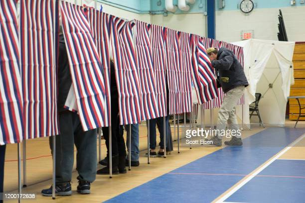 Voters fill out their ballots at the Broken Ground School during the presidential primary on February 11 2020 in Concord New Hampshire