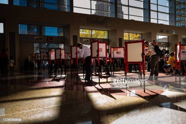 Voters fill out their ballots at the KFC YUM! Center on October 13, 2020 in Louisville, Kentucky. Tuesday marked the first day of early in-person...