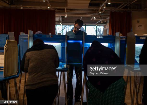 Voters fill out their ballots at the Minneapolis College of Art and Design on November 6 2018 in Minneapolis United States Voters in Minnesota will...
