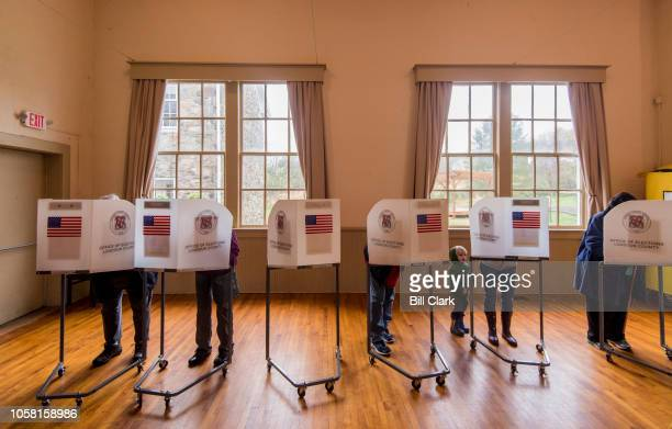 Voters fill out their ballots at the Old Stone School polling location in Hillsboro Va on Election Day Nov 6 2018