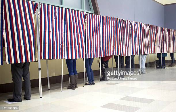 Voters fill out their ballots in the patriotic voting booths at Merrill Auditorium with a hour and 20 minutes to go before the polls close