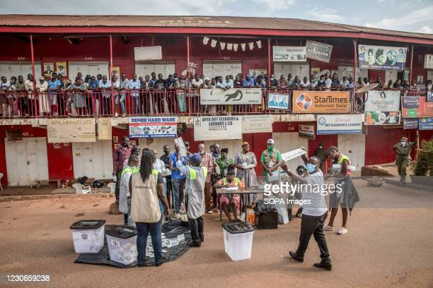 Voters gather to watch ballots being counted in Bugolobi, Kampala, on the afternoon of Uganda's presidential elections. Uganda's elections, on...