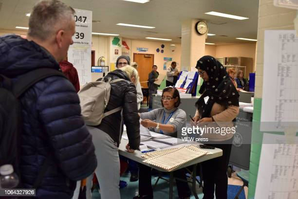 Voters go to the polls in the midterm elections at PS 69 on November 6 2018 in the Jackson Heights neighborhood of the Queens borough of New York City