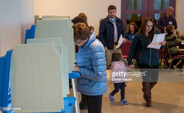 Voters go to the polls to cast their midterm ballots at the Annunciation Greek Orthodox Church Cultural Center on November 6 2018 in Wauwatosa...