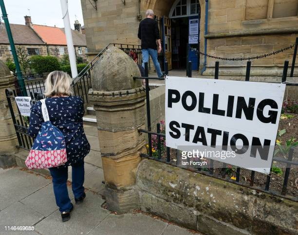Voters head into a polling station during local elections on May 02 2019 in Loftus United Kingdom Elections are being held in 248 councils across...