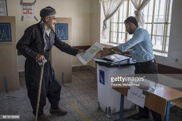 Voters head to polling stations to cast their vote for the Iraqi parliamentary election on May 12 2018 in Erbil Iraq Citizens are voting in the first...