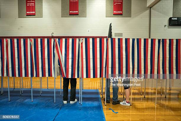 Voters head to the polling booths inside the Bedford High school February 9 2016 in Bedford New Hampshire