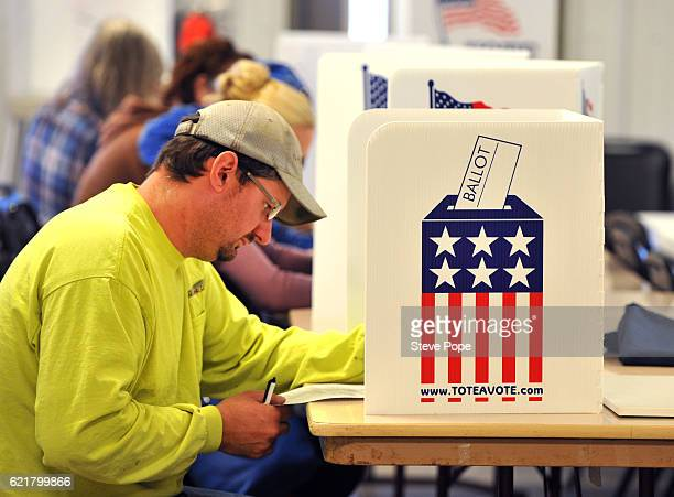 Voters head to the polling place on November 8 2016 in Redfield Iowa Americans today will choose between Republican presidential candidate Donald...