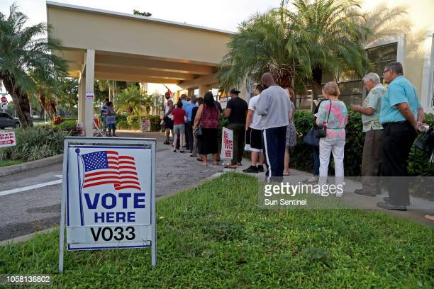 Voters in Hollywood line up as the polls open at David Park Community Center Tuesday, Nov. 6, 2018.