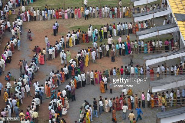 voters in queue polling station, mumbai, maharashtra, india, asia - election stock pictures, royalty-free photos & images