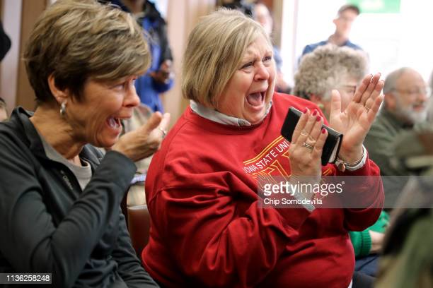 Voters laugh at a joke told by US Sen Amy Klobuchar as she talks with voters while campaigning for the Democratic presidential nomination at the...