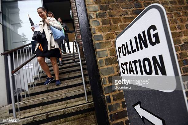 Voters leave after casting their vote in the European Union referendum at the Hanover Primary school polling station in London UK on Thursday June 23...