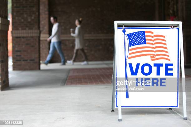 Voters leave the polling station set up at Noonday Baptist Church for the midterm elections on November 6 2018 in Marietta Georgia Georgia has a...