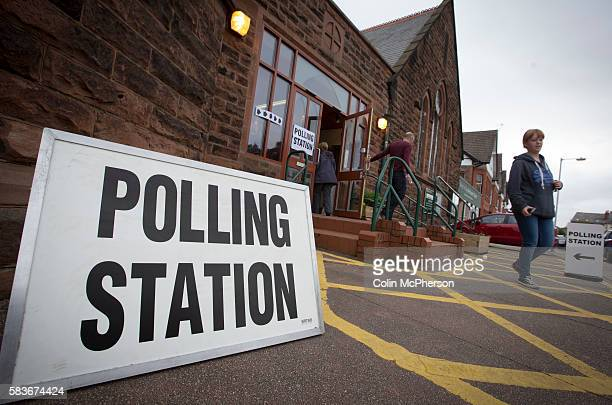 Voters leaving a polling station in West Kirby, Wirral after casting their votes at the 2015 UK General Election. They were voting in the marginal...