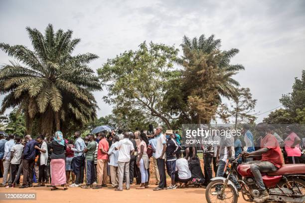 Voters line up at the opposition leader Bobi Wine whose real name is Robert Kyagulanyi's local polling station in Magere, on the outskirts of...