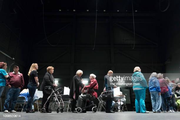 RICHMOND KENTUCKY USA NOVEMBER 6 2018 Voters line up by precinct to receive their ballot at the Eastern Kentucky University's Center for the Arts in...