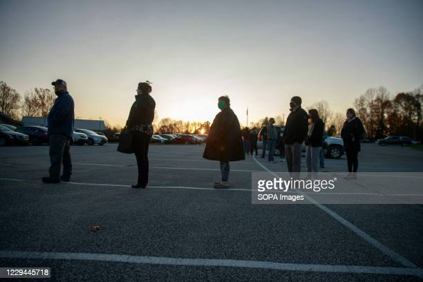 Voters line up on Election Day 2020 to cast their ballots at St. John the Apostle Catholic Church. Polling stations across the United States open for...