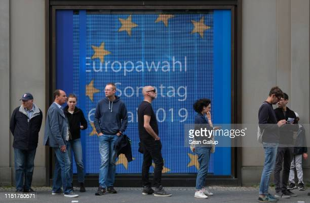 Voters line up outside a display of the European Commission to cast their ballots at the French Embassy in European parliamentary elections on May 26...