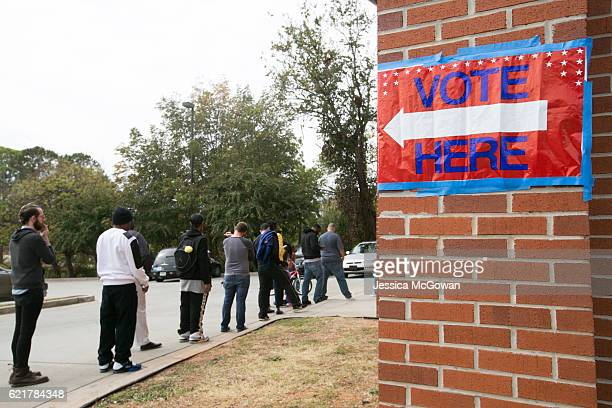 Voters line up outside Liberty Baptist Church to cast their ballot in the 2016 Presidential Election on November 8 2016 in Atlanta Georgia Americans...