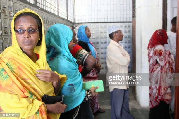 Voters line up to cast their ballot at the Badjanani voting station in Moroni Comoros on April 10 2016 during the second round of Presidential...