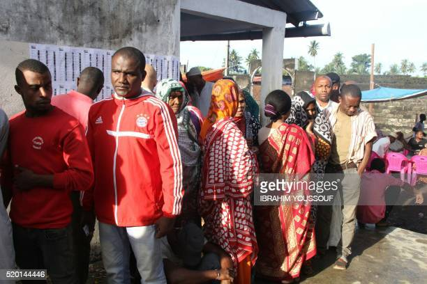 Voters line up to cast their ballot in Mitsoudjé on April 10 2016 during the second round of Presidential elections in Comoros Voters head to the...