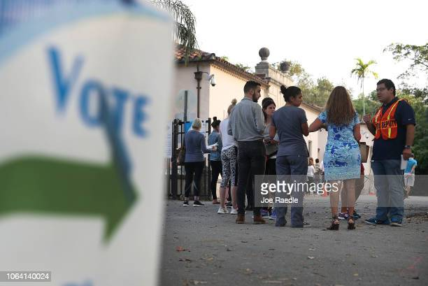 Voters line up to cast their ballot just before the polls open in the midterm election on November 06 2018 in Miami United States The political races...