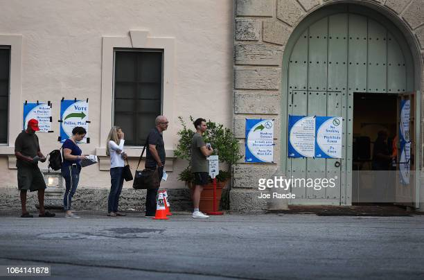 Voters line up to cast their ballot just before the polls open in the mid-term election on November 06, 2018 in Miami, Florida. The political races...
