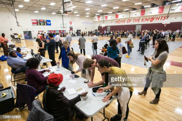 Voters line up to cast their ballots at a polling station set up at Grady High School for the midterm elections on November 6 2018 in Atlanta Georgia...