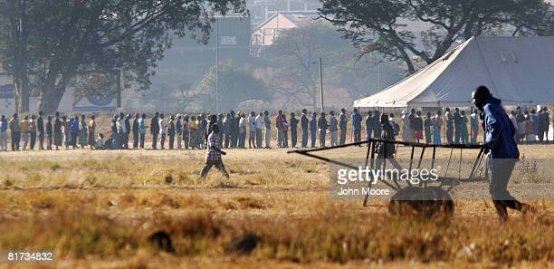 Voters line up to cast their ballots on June 27 2008 in Harare Zimbabwe The runoff presidential election which is being boycotted by oppostion leader...