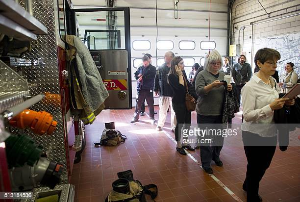 Voters line up to vote during the Super Tuesday primary voting at a polling place located in at Fire Station in Arlington Virginia March 1 2016...