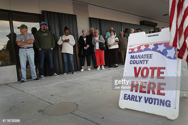 Voters line up to vote early at the Supervisor of Elections office on October 24 2016 in Bradenton Florida Today early general election voting...