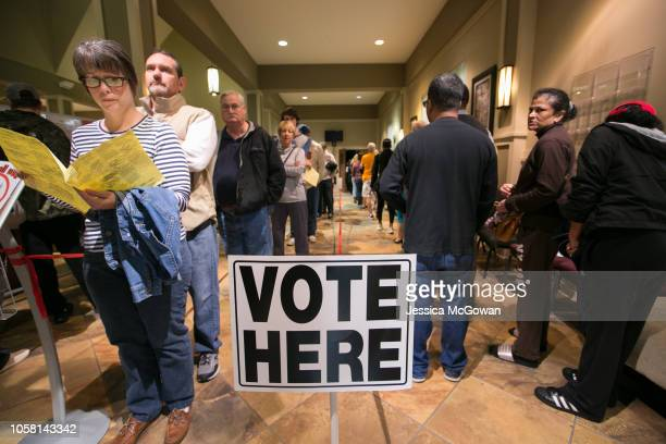 Voters lineup to cast their ballots at a polling station set up at Noonday Baptist Church for the midterm elections on November 6 2018 in Marietta...