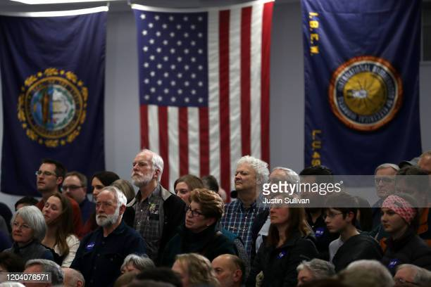 Voters look on as Democratic presidential candidate former Vice President Joe Biden speaks during a campaign event on February 04 2020 in Concord New...
