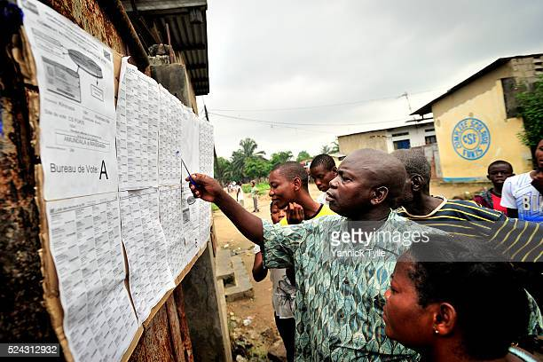 Voters looking for their name at a polling station in Makala a suburb in Kinshasa capital of the Democratic Republic of Congo Voters headed to the...