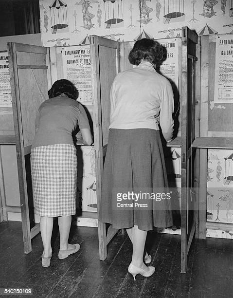 Voters make their selection for the General Election at the polling station within the Bromley College of Arts, 8th October 1959.