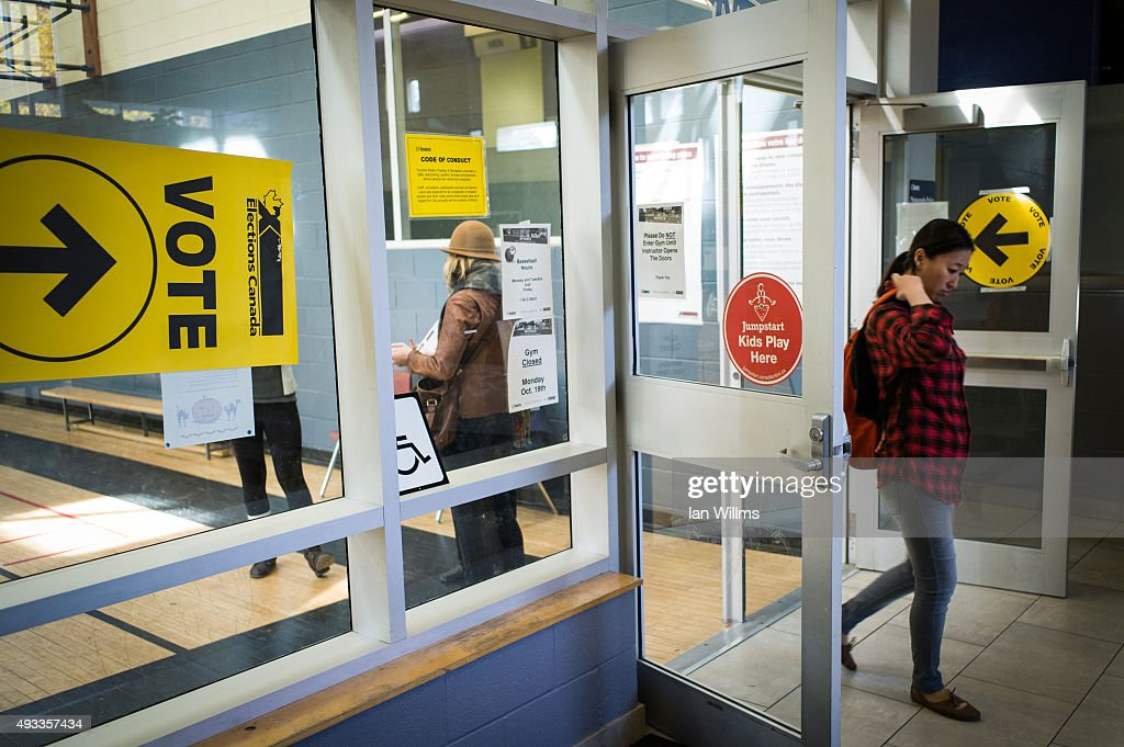 Voters make their way in and out of the polling station at the Mary McCormick Recreation Centre, in Toronto's Davenport riding, during the 42nd Canadian general election October 19, 2015 in Toronto, Ontario, Canada. Canadians went to the polls to decide whether to continue 10 years of conservative rule with current Prime Minister Stephen Harper or go with Justin Trudeau and a new Liberal Party.