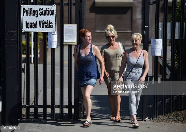 Voters make their way to and from a polling station situated at St Anne's national school on May 25 2018 in Dublin Ireland Voters in Ireland will...