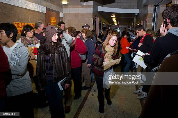 Voters many college students wait for over two hours to cast their ballots at a polling site on the campus of Iowa State University