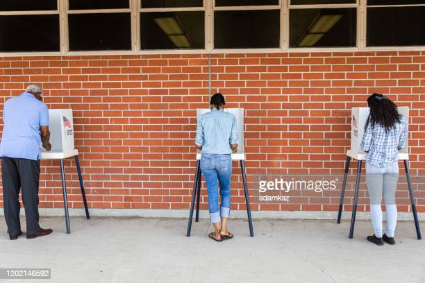 voters on election day - polling place stock pictures, royalty-free photos & images