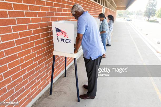 voters on election day - black civil rights stock pictures, royalty-free photos & images