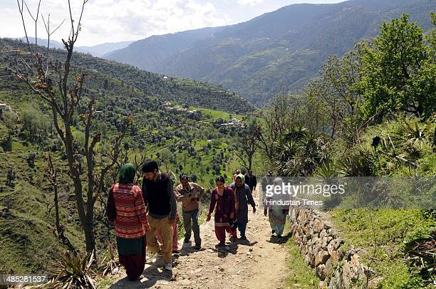 Voters on their way to cast their vote in a polling station at Babbore village Doda on April 17 2014 in Jammu India India is headed for 9phase...
