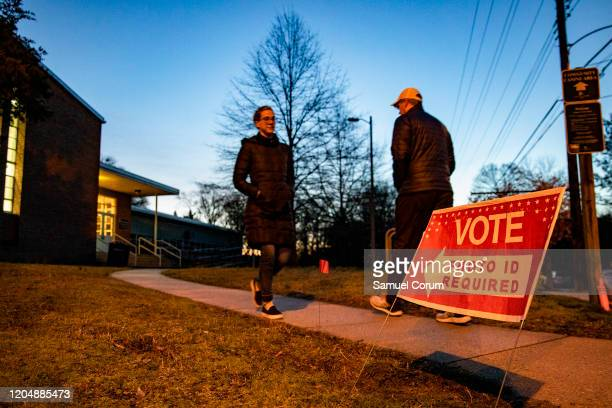 Voters outside of the Madison Community Center polling place for the Democratic presidential primary on Super Tuesday on March 3 2020 in Arlington VA...